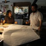 Denise Burchstead, who teaches at Keene State, consults with Aitan in the studio.