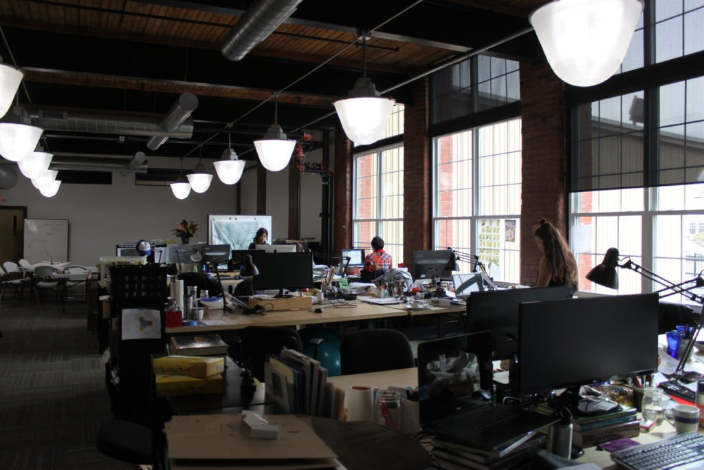 The renovated mill space is spacious and flexible, and the large windows provide ample natural light during the day.
