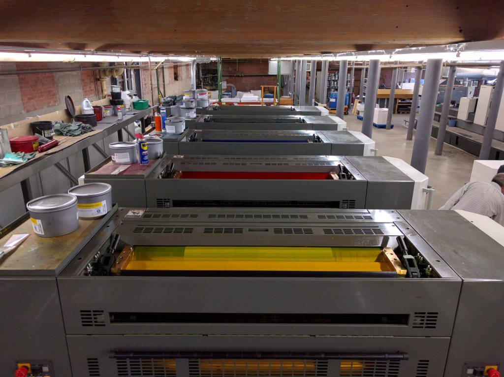 This high-tech full color press is in the basement of the brick industrial building that houses Hadley Printing and was used to print the covers.